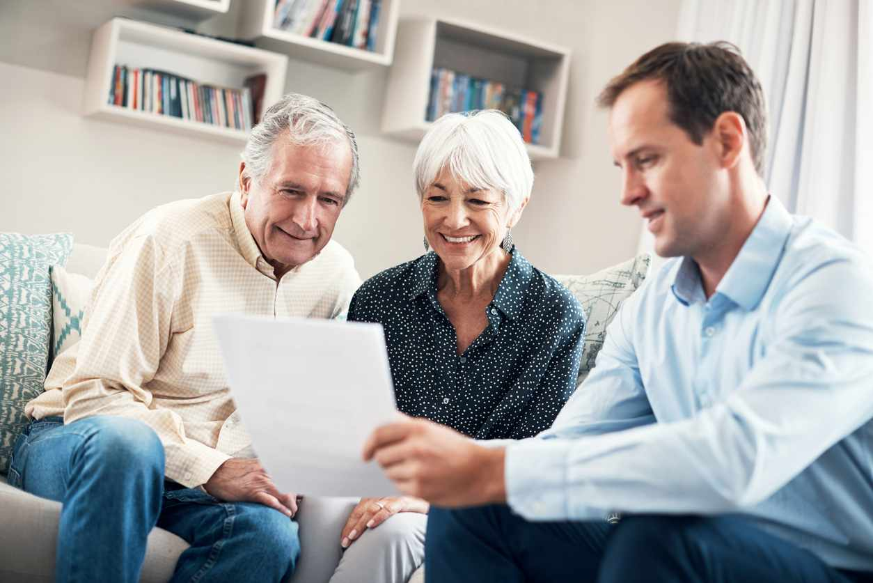 Shot of a senior couple getting advice from their financial consultant at home