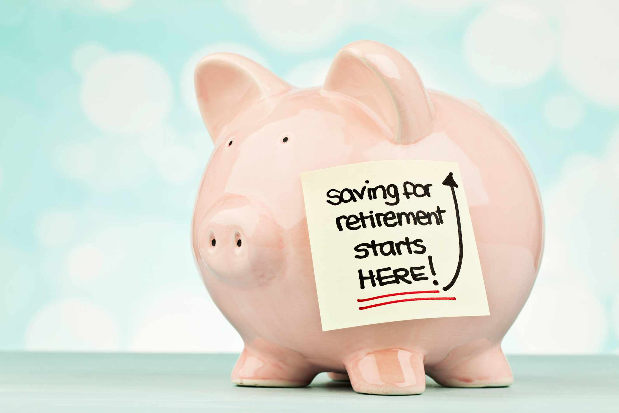 Piggy bank with message promoting saving for retirement
