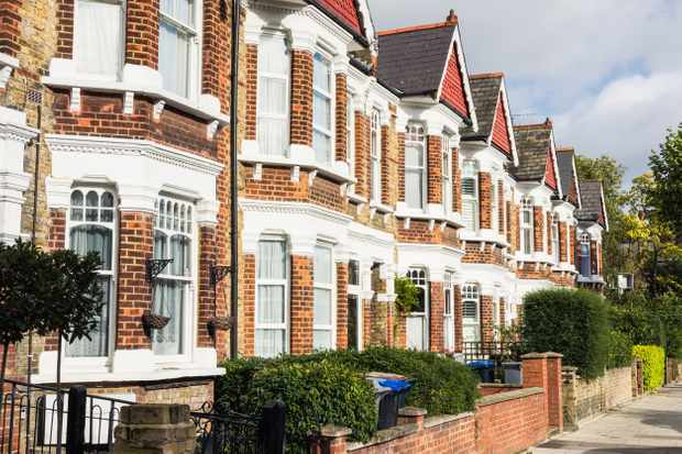 A row of terraced houses in the Queen's Park area of London.