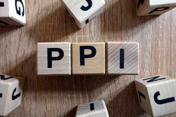 PPI word (Payment Protection Insurance) from wooden blocks on desk