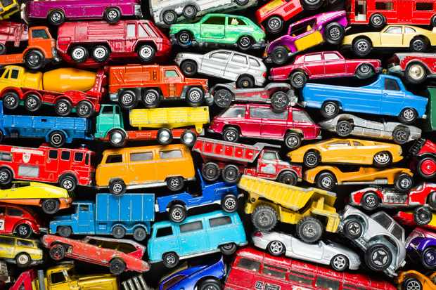 Scrap heap of vintage toy cars