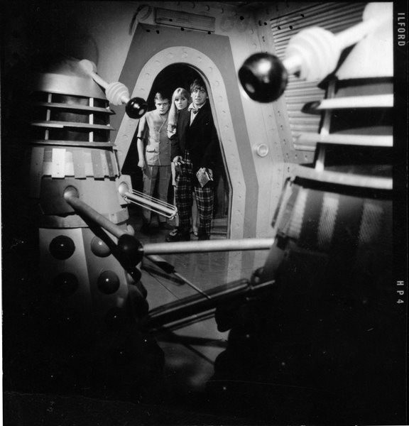The Doctor and his companions Ben (Michael Craze) and Polly (Anneke Wills) discover two dormant Daleks inside a mysterious space capsule. This shot was taken during rehearsals for episode one. For the actual recording, the Daleks were festooned in cobwebs. Shot number RT 3700 15.