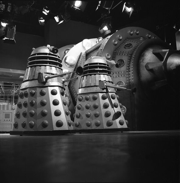 The Daleks alongside their capsule in Lesterson's laboratory, with the lights of the BBC's Riverside Studio One visible above. Shot number RT 3700 52.