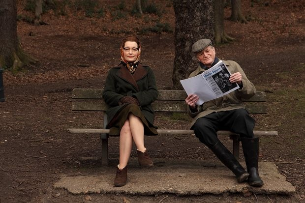 Lesley Manville as Heather Hartnell and David Bradley as William Hartnell on Wimbledon Common, filming An Adventure in Space and Time on 4 February 2013. Radio Times asked them to pose with a mock-up of Hartnell's first RT cover as Doctor Who from 1964.