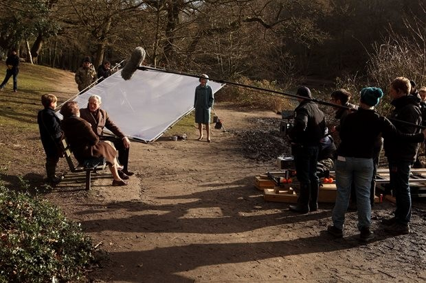 The cast and crew prepare for another shot on Wimbledon Common.