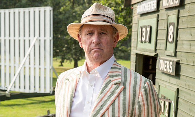 Yes, that is Doctor Who's Peter Davison in Grantchester