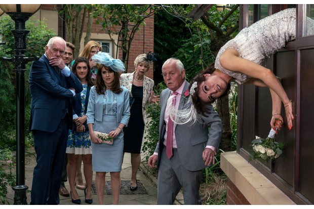 Bride in distress as she is trapped whilst escaping from her own wedding