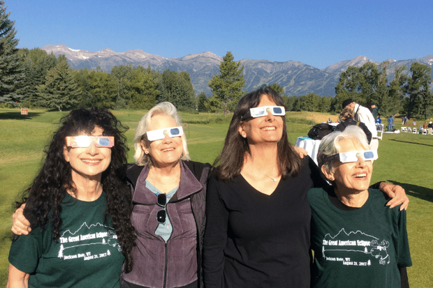 Astronomer Dava Sobel and friends looking at an eclipse