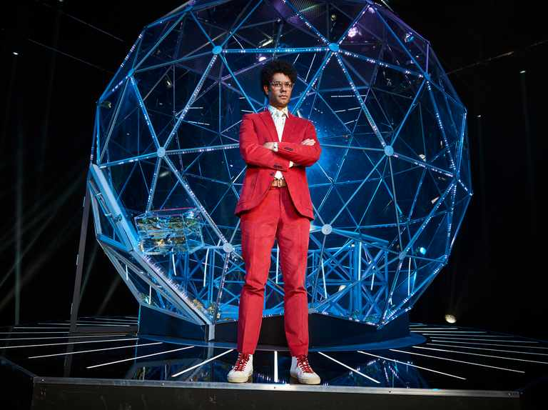 When is The Crystal Maze on TV? Who is the host, what are the zones, and who are the celebrity contestants?