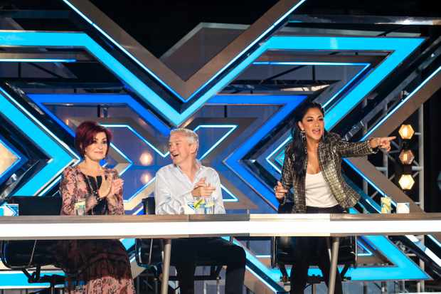 Where's Simon Cowell? Louie Walsh takes charge on The X Factor with Sharon Osbourne and Nicole Scherzinger