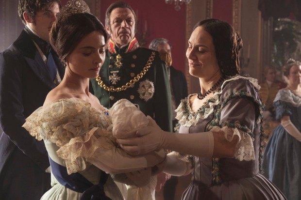 Victoria hands over the baby (ITV)