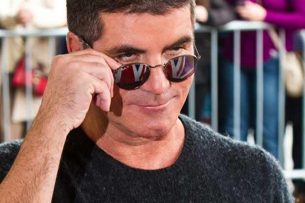 Simon Cowell wearing sunglasses