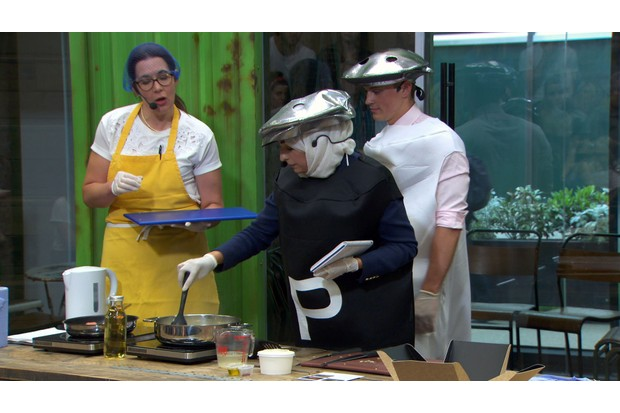 Bushra, Elizabeth and James demonstrate their recipe during the gourmet food pitch (BBC, TL)