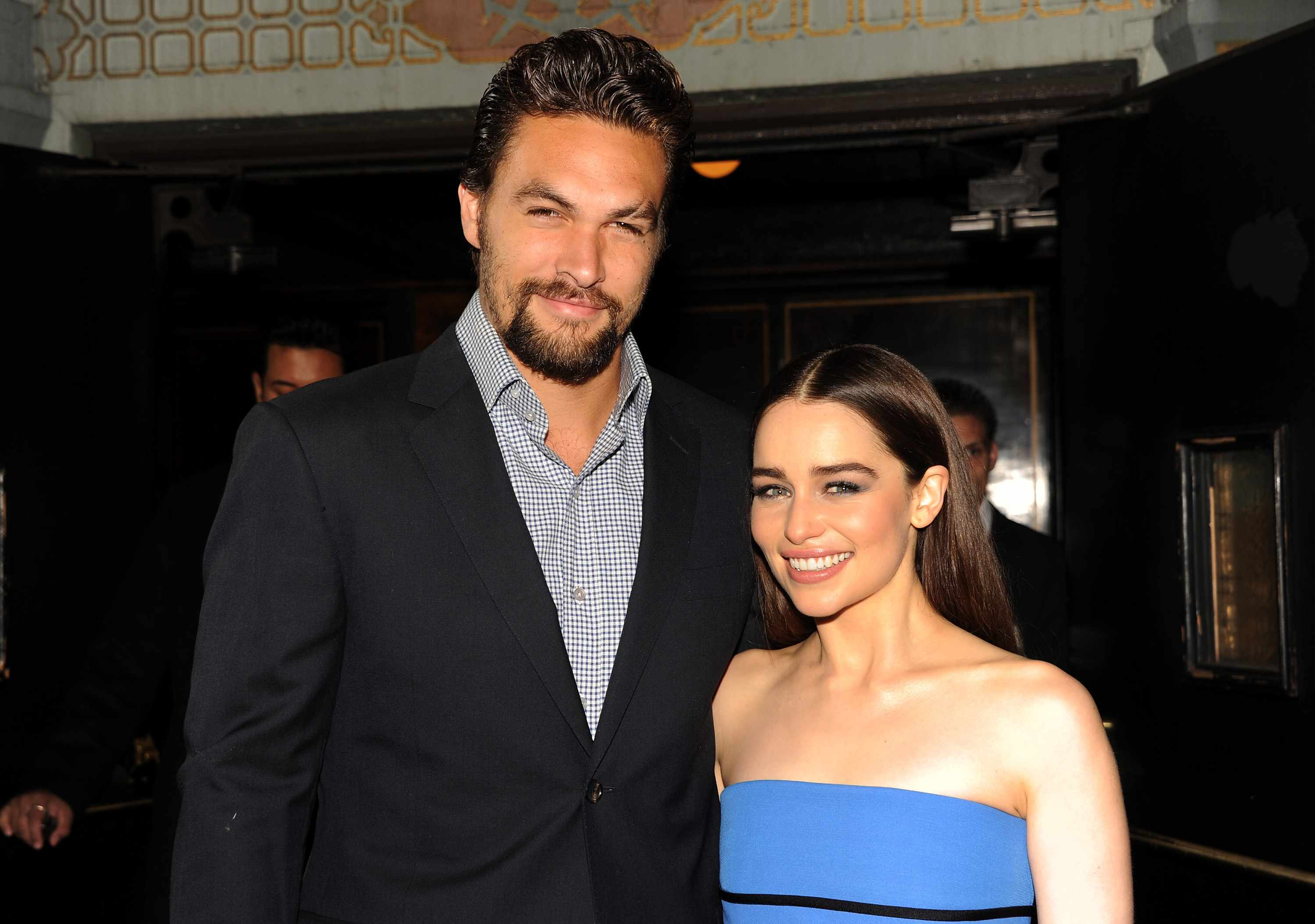 """HOLLYWOOD, CA - MARCH 18:  Actors Jason Momoa (L) and Emilia Clarke arrive at the premiere of HBO's """"Game Of Thrones"""" Season 3 at TCL Chinese Theatre on March 18, 2013 in Hollywood, California.  (Photo by Kevin Winter/Getty Images, BA)"""