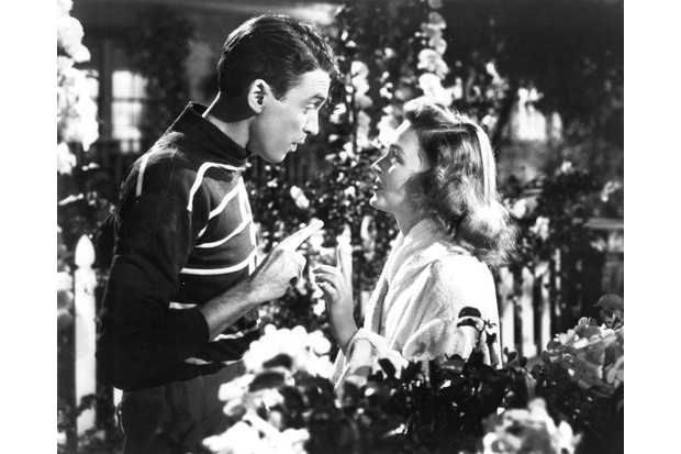 American actors James Stewart (1908 - 1997) as George Bailey, and Donna Reed (1921 - 1986) as Mary Hatch Bailey in a promotional still from 'It's A Wonderful Life', directed by Frank Capra, 1946. (Photo by Silver Screen Collection/Getty Images, BA)