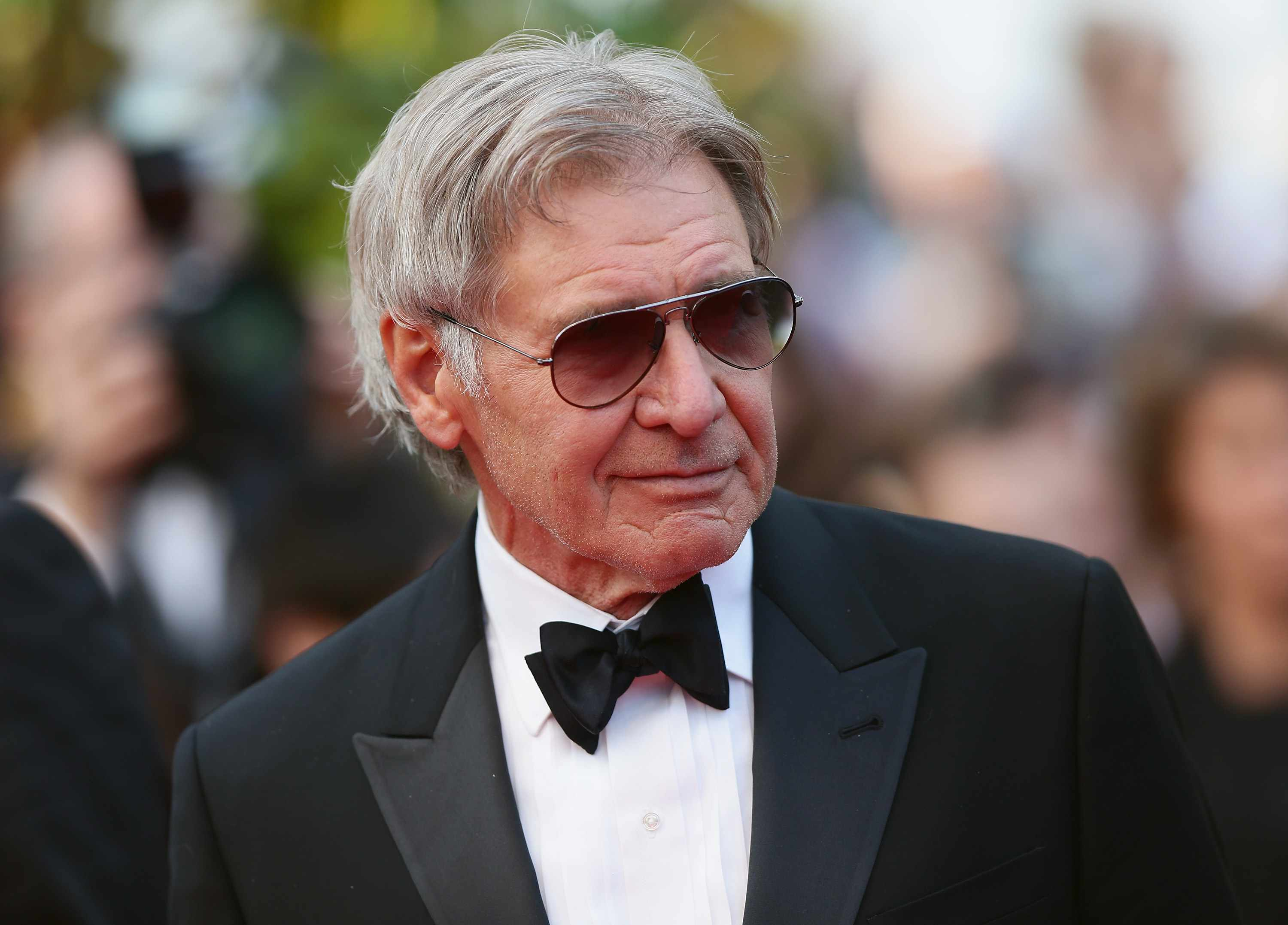 """CANNES, FRANCE - MAY 18:  Harrison Ford attends """"The Expendables 3"""" premiere during the 67th Annual Cannes Film Festival on May 18, 2014 in Cannes, France.  (Photo by Vittorio Zunino Celotto/Getty Images)"""