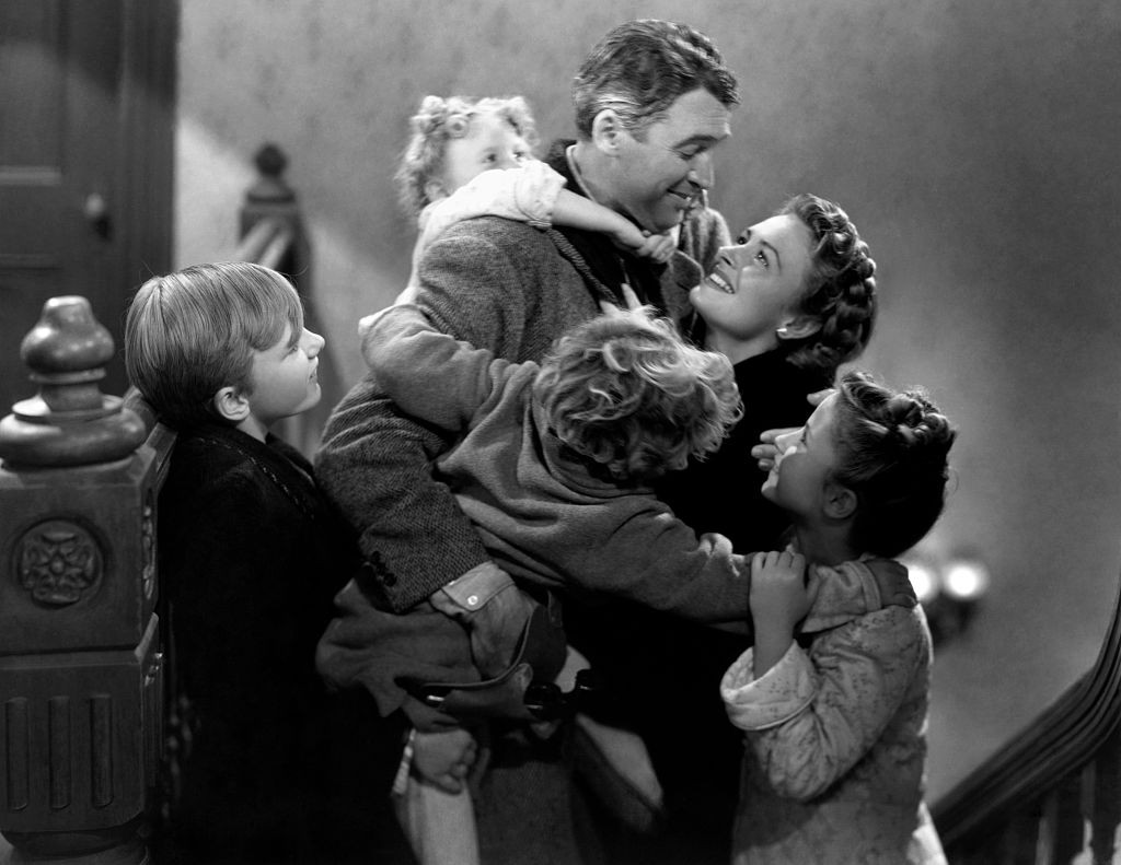 Clockwise from top: James Stewart, Donna Reed, Carol Coombs, Jimmy Hawkins, Larry Simms and Karolyn Grimes. (Photo by Herbert Dorfman/Corbis via Getty Images, BA)