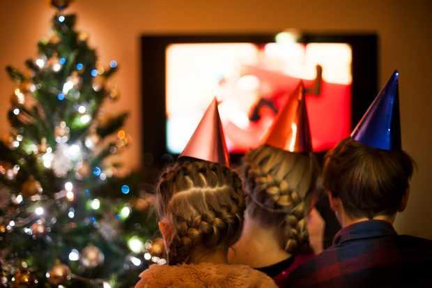 Children Watching TV on Christmas Eve