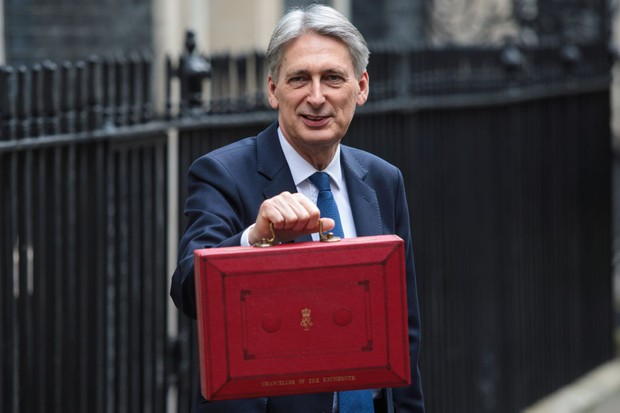 LONDON, ENGLAND - MARCH 08: British Chancellor of the Exchequer Philip Hammond holds the budget box outside 11 Downing Street on March 8, 2017 in London, England. Today's Budget will be the last one to take place in the spring. It is being replaced by an annual autumn Budget, the first of which is to be held later this year. The current Chancellor wants to simplify the process of setting taxes and government spending. (Photo by Jack Taylor/Getty Images)