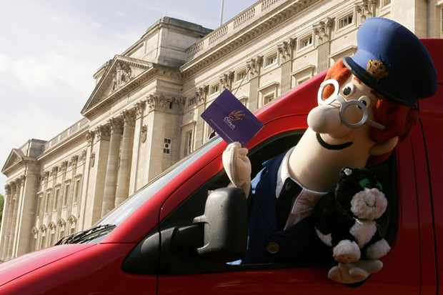 LONDON, United Kingdom:  **** EMBARGOED FOR PUBLICATION UNTIL 2301 GMT 23 MAY 2006 ****  An actor dressed in the costume of animated children's television character Postman Pat leaves Buckingham Palace in London, 23 May 2006, as he prepares to deliver invitations to various British schools inviting some lucky children to a 'Children's Party at the Palace' on June 25. Postman Pat is expected to personally deliver the invitaions to the children who will attend a special tea party and live show in the Garden of Buckingham Palace. AFP PHOTO/CARL DE SOUZA  (Photo credit should read CARL DE SOUZA/AFP/Getty Images, BA)