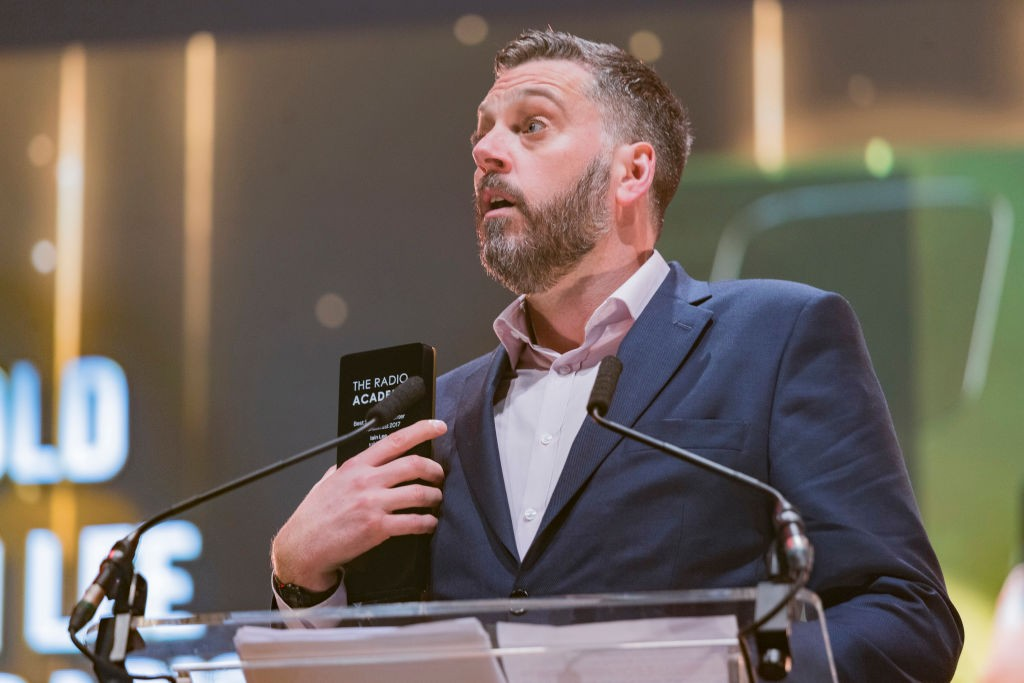 LEEDS, ENGLAND - OCTOBER 19:  Iain Lee wins an award at the Audio & Radio Industry Awards at First Direct Arena Leeds on October 19, 2017 in Leeds, England.  (Photo by Andrew Benge/Redferns, BA)