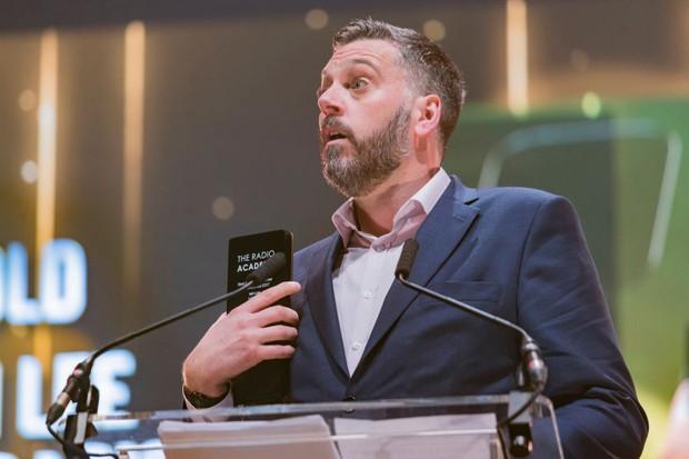 LEEDS, ENGLAND - OCTOBER 19:  Iain Lee wins an award at the Audio & Radio Industry Awards at First Direct Arena Leeds on October 19, 2017 in Leeds, England.  (Photo by Andrew Benge/Redferns, BA)