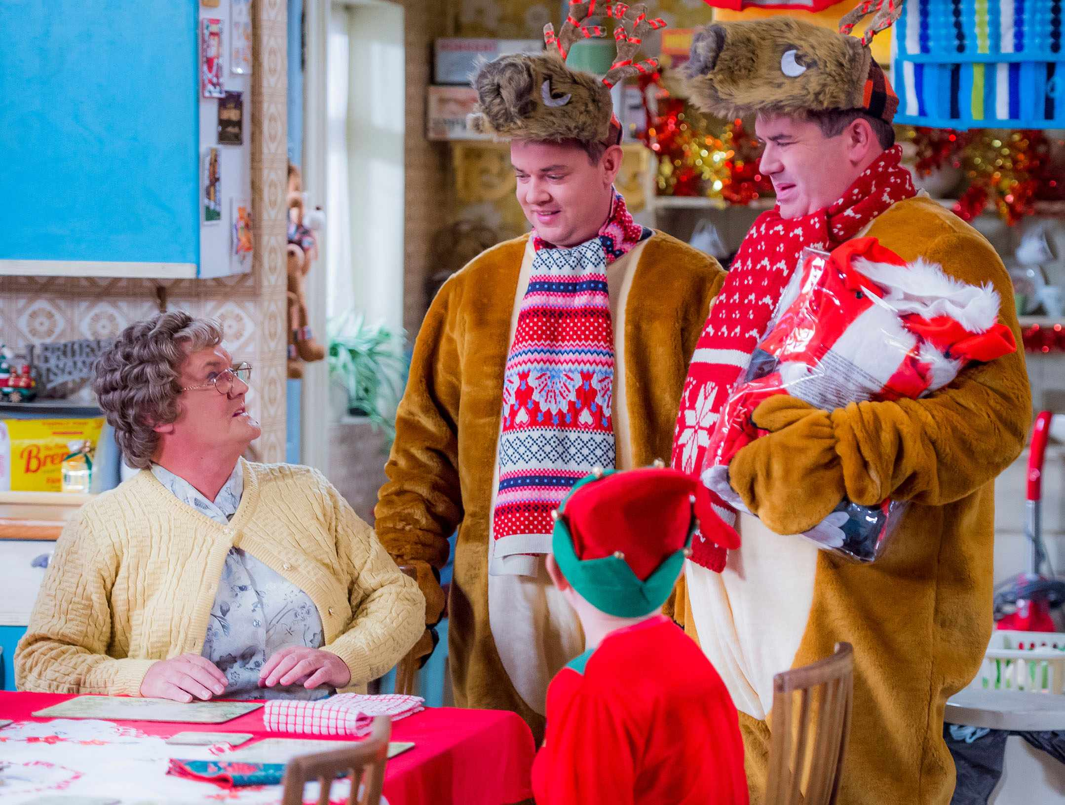 Programme Name: Mrs Brown's Boys Christmas and New Year Special 2017 - TX: n/a - Episode: n/a (No. n/a) - Picture Shows: *STRICTLY EMBARGOED UNTIL SATURDAY 9TH DECEMBER 00:01HR** (L-R) Mrs Brown (BRENDAN O'CARROLL), Buster Brady (DANNY O'CARROLL), Bono Brown (JAMIE O'CARROLL), Dermot Brown (PADDY HOULIHAN) - (C) BBC Studios - Photographer: Alan Peebles  (BBC, TL)
