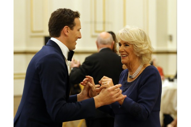 LONDON, UNITED KINGDOM - NOVEMBER 22: Camilla, Duchess of Cornwall, President of the National Osteoporosis Society, dances with 'Strictly Come Dancing' professional dancer Brendan Cole as she hosts a tea dance to highlight the benefits for older people of staying active, at Buckingham Palace on November 22, 2017 in London, United Kingdom. (Photo by Gareth Fuller - WPA Pool/Getty Images)