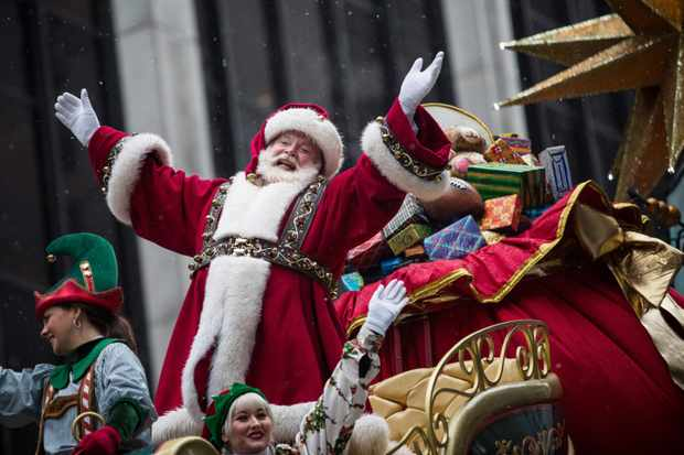 NEW YORK, NY - NOVEMBER 27:  Santa Claus waves to the crowd during the Macy's Thanksgiving Day Parade on November 27, 2014 in New York City. The annual tradition marks the start of the holiday season.  (Photo by Andrew Burton/Getty Images) TL
