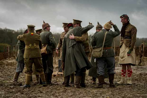 A recreation of the Christmas Day truce that took place in 2014 to celebrate 100 years since the truce (Getty, TL)