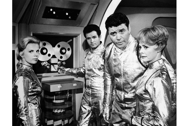 (Original Caption) Space Travelers. Marta Kristen, Mark Goddard, Guy Williams, and June Lockhart (left to right) play four of the voyagers making their first trip into outer space in the premiere episode of Lost in Space, Wednesday, September 15 (7:30-8:30 p.m., EDT) on the CBS Television Network. 1967. (Getty, BA)
