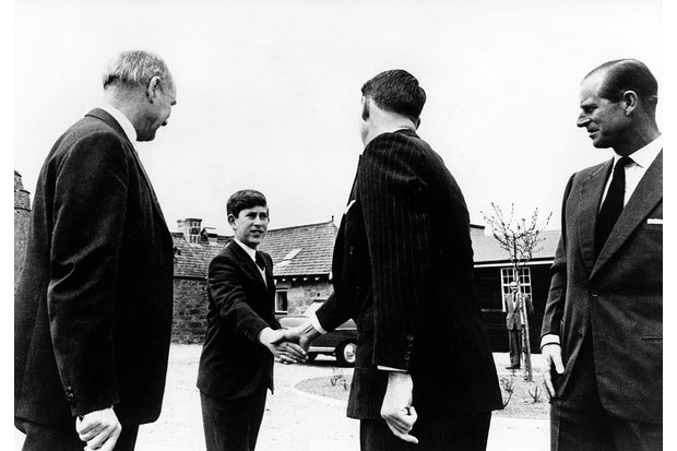 Prince Charles greets the headmaster as he arrives at Gordonstoun