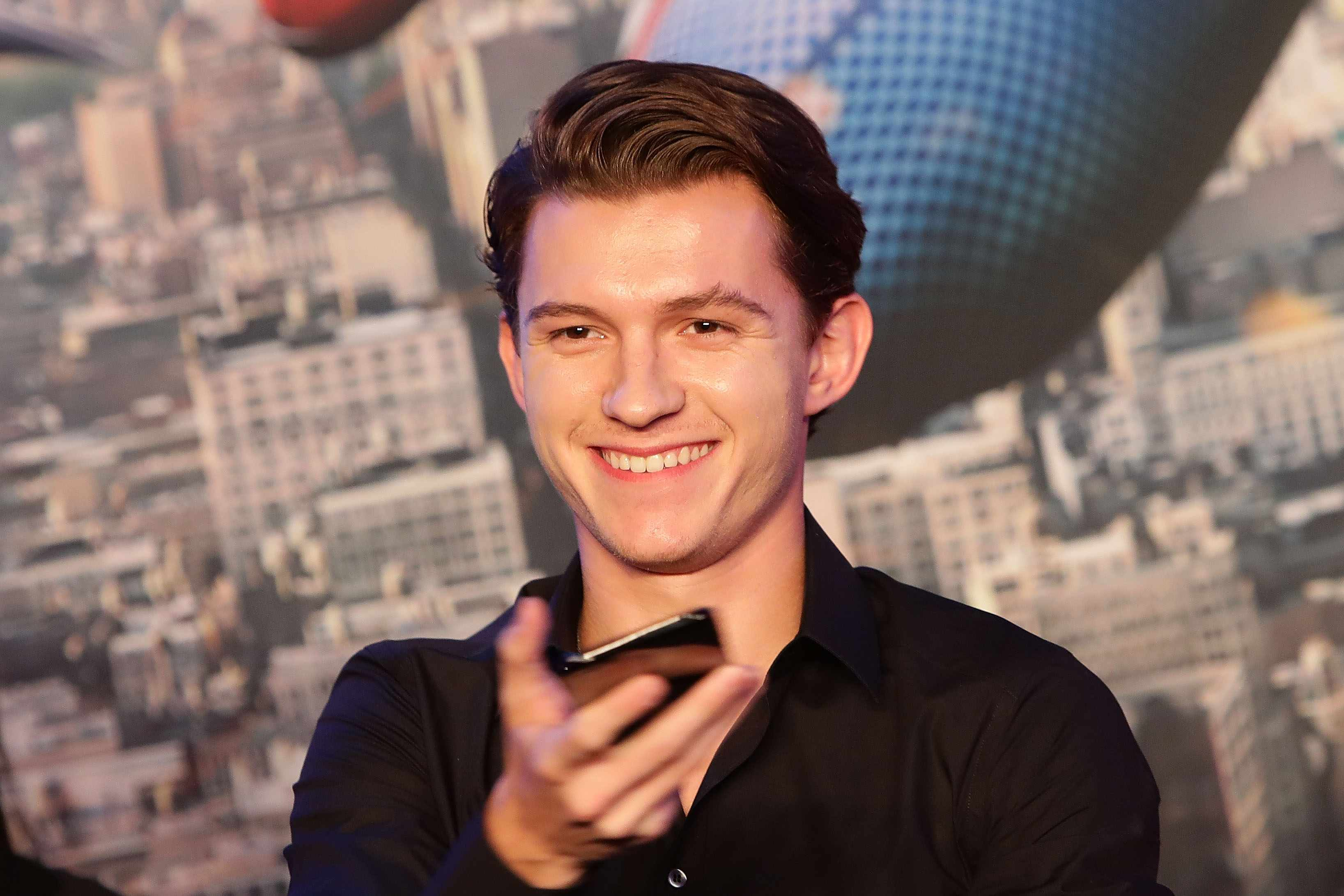 Tom Holland (Getty, TL)