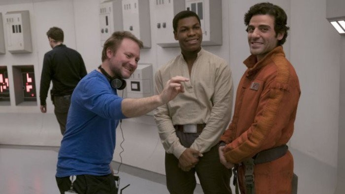 Director Rian Johnson with actors John Boyega and Oscar Isaac on the set of The Last Jedi