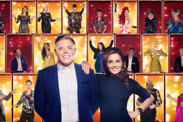 WARNING: Embargoed for publication until 00:00:01 on 29/12/2017 - Programme Name: All Together Now - TX: n/a - Episode: n/a (No. n/a) - Picture Shows: L-R, Presenter Rob Beckett with Geri Horner, and the 100. Rob Beckett, Geri Horner - (C) Endemol - Photographer: Ray Burmiston (foreground) & Matt Squire (background)  BBC, TL