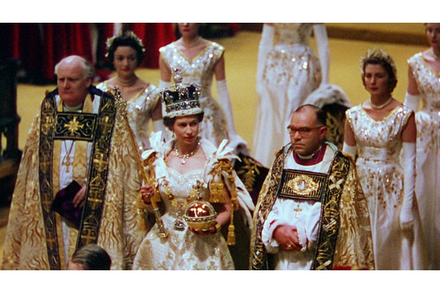 Programme Name: The Coronation - TX: n/a - Episode: n/a (No. n/a) - Picture Shows: Her Majesty the Queen with her maids of honour and Archbishop of Canterbury during the coronation. **Must credit ITV Archive. For single use only and only in connection with editorial about 'The Coronation' on BBC One, Smithsonian and ABC and distributed by FreMantle Images must not be archived, edited, or sold-on.** Her Majesty The Queen - (C) ITV Archive - Photographer: ITV Archive