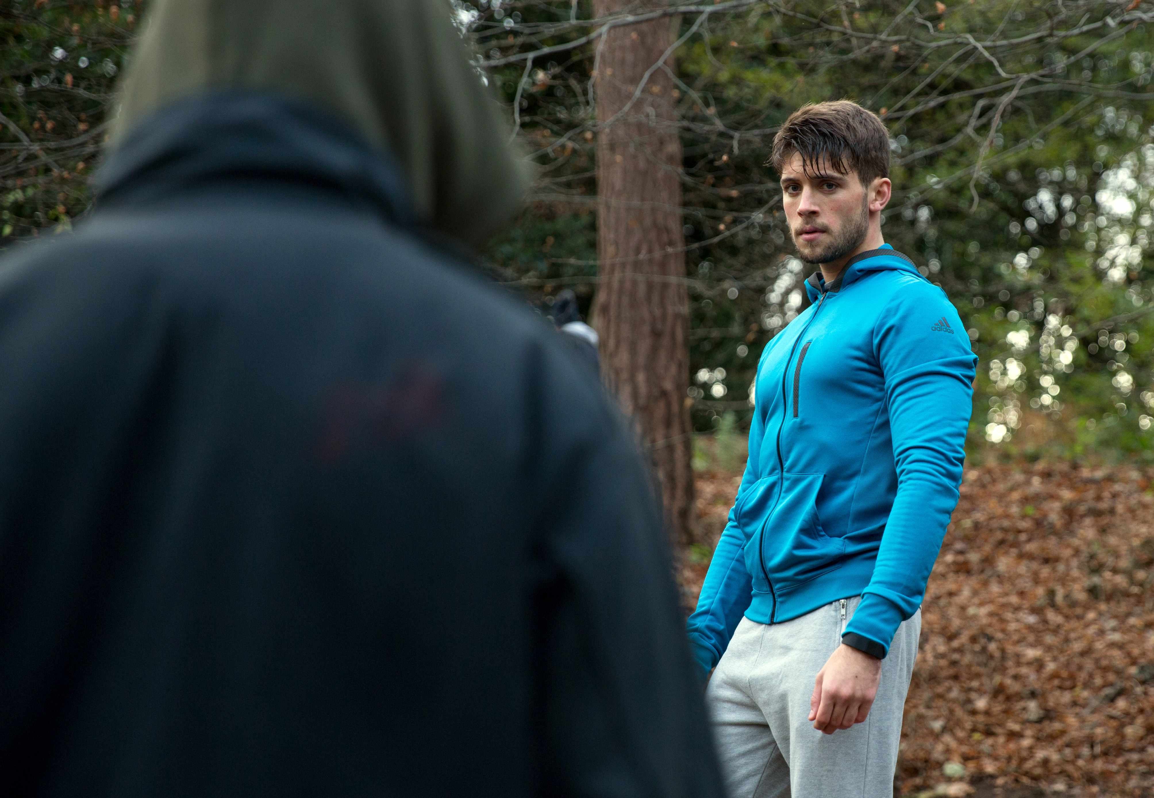 FROM ITV   STRICT EMBARGO  Print media - No Use Before Tuesday 16 January 2018 Online Media -  No Use Before 0700hrs Tuesday 16 January 2018  Emmerdale - Ep 8050  Tuesday 23rd January 2018  Joe Tate [NED PORTEOUS] jogs through the woods and comes face-to-face with a man in a mask. The man approaches with a shotgun and Joe scrambles away, falling over a trip- wire. He manages to get up but as he makes a run for it he falls into a pit covered by some moss. JoeÕs petrified as the gunman leaves him to die.    Picture contact - david.crook@itv.com  Photographer - Amy Brammall  This photograph is (C) ITV Plc and can only be reproduced for editorial purposes directly in connection with the programme or event mentioned above, or ITV plc. Once made available by ITV plc Picture Desk, this photograph can be reproduced once only up until the transmission [TX] date and no reproduction fee will be charged. Any subsequent usage may incur a fee. This photograph must not be manipulated [excluding basic cropping] in a manner which alters the visual appearance of the person photographed deemed detrimental or inappropriate by ITV plc Picture Desk. This photograph must not be syndicated to any other company, publication or website, or permanently archived, without the express written permission of ITV Plc Picture Desk. Full Terms and conditions are available on the website www.itvpictures.com