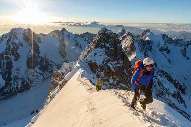 Two climbers arrive on the summit of the Aiguille Verte
