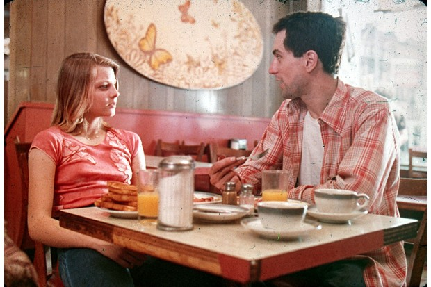 1976: American actors Jodie Foster and Robert De Niro sit together at a diner in a still from the film, 'Taxi Driver' directed by Martin Scorsese. (Photo by Columbia Pictures/Fotos International/Getty Images)
