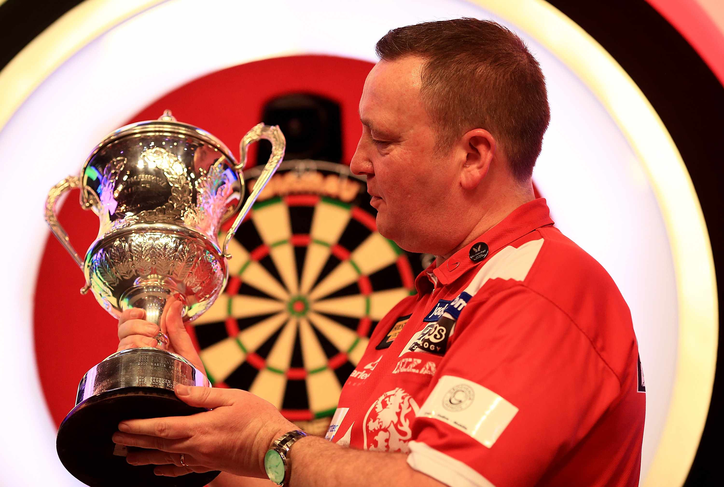FRIMLEY, ENGLAND - JANUARY 15:  Glen Durrant of England celebrates with the trophy after defeating Danny Noppert of The Netherlands in the final of The BDO Lakeside World Professional Darts Championships on January 15, 2017 in Frimley, England.  (Photo by Ben Hoskins/Getty Images)