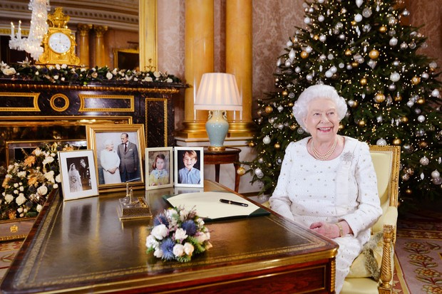 LONDON, UNITED KINGDOM -  In this undated image supplied by Sky News, Queen Elizabeth II sits at a desk in the 1844 Room at Buckingham Palace, after recording her Christmas Day broadcast to the Commonwealth at Buckingham Palace, London.  (Photo by John Stillwell - WPA Pool/ Getty Images, BA)