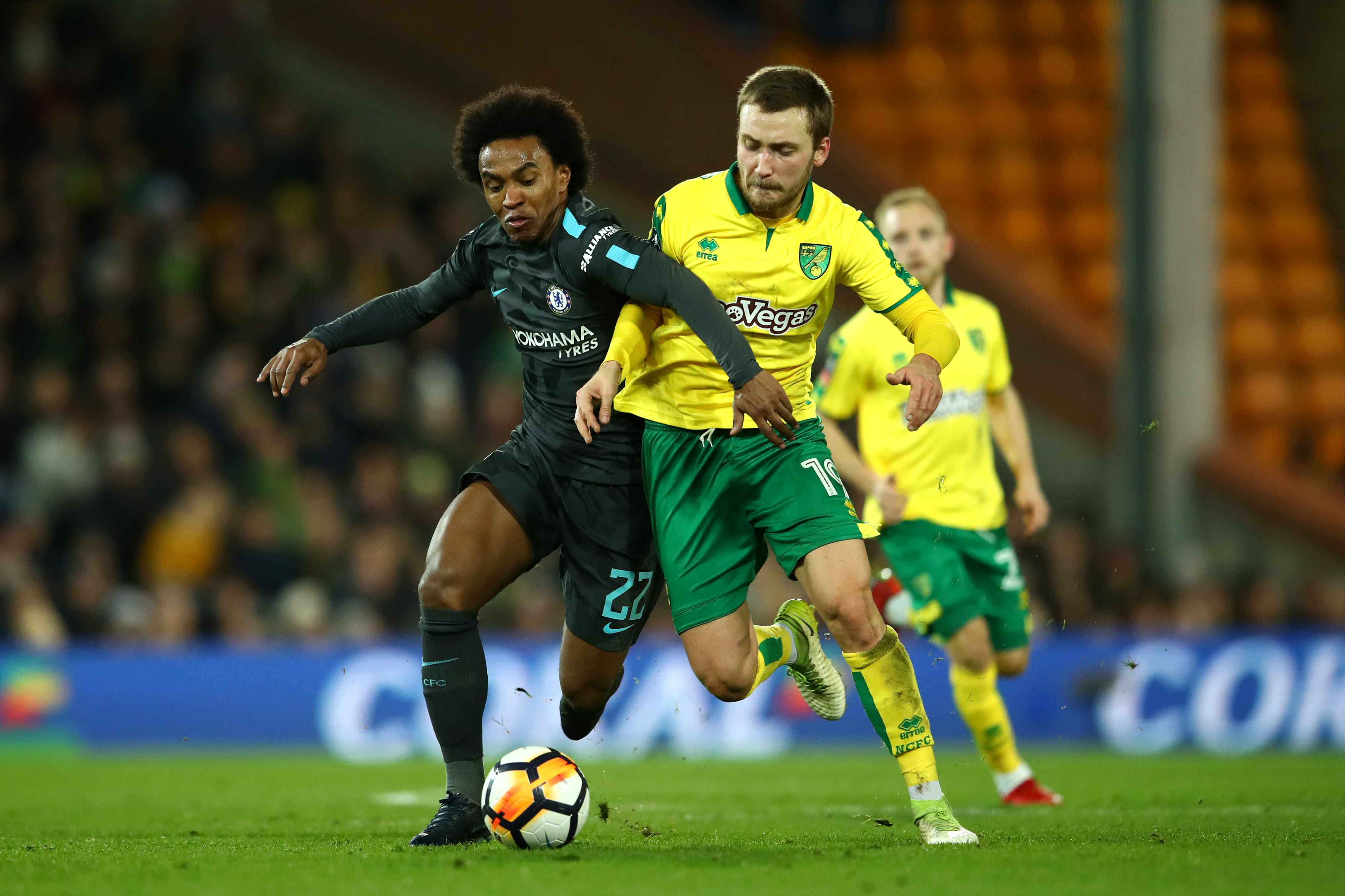 NORWICH, ENGLAND - JANUARY 06:  Willian of Chelsea challenges Tom Trybull of Norwich City during the Emirates FA Cup Third Round match between Norwich City and Chelsea at Carrow Road on January 6, 2018 in Norwich, England.  (Photo by Clive Mason/Getty Images)  TL