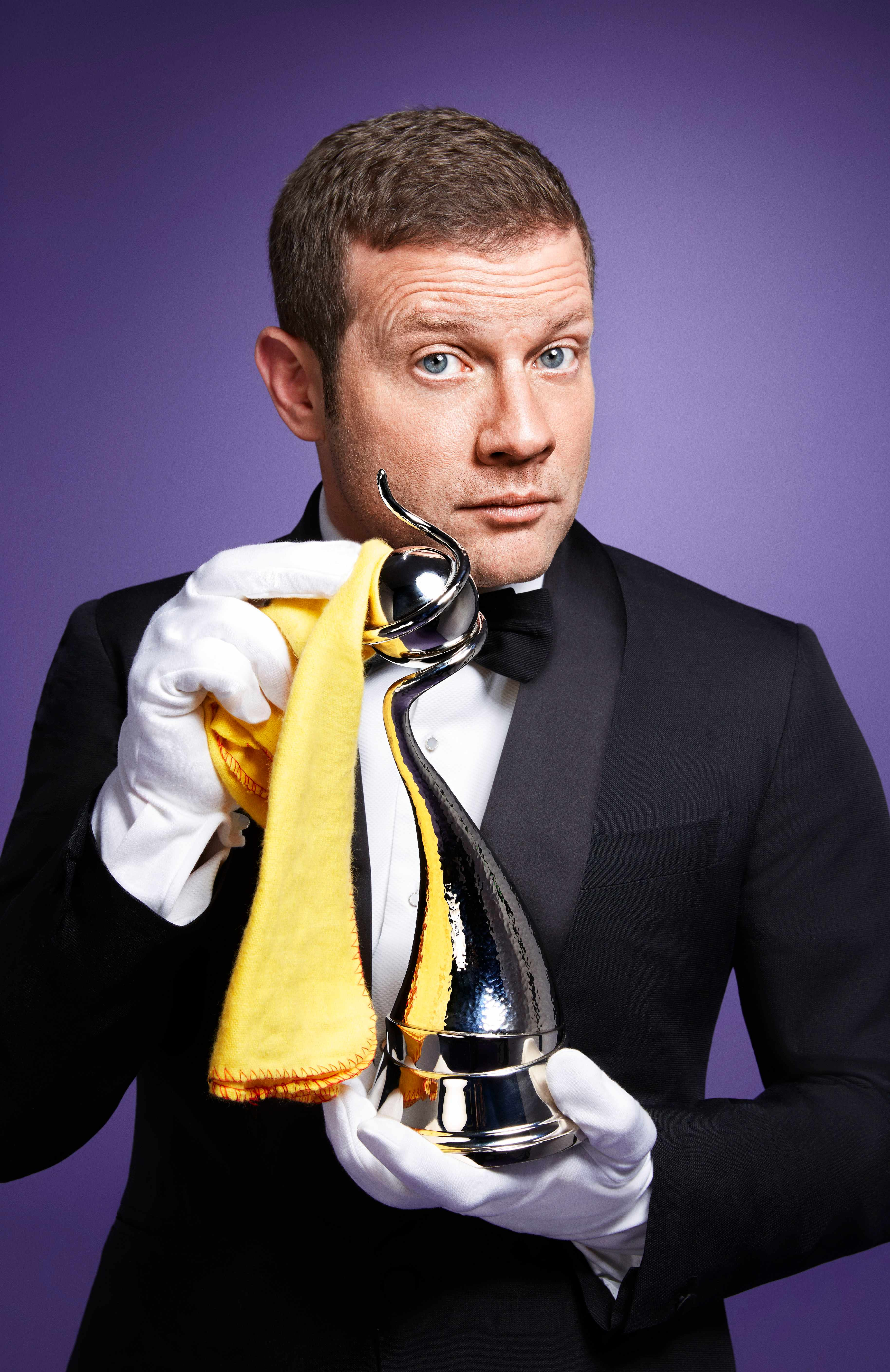 From Indigo Productions   THE 23RD NATIONAL TELEVISION AWARDS  Tuesday 23rd January 2018, 7.30pm, ITV  Pictured: Host Dermot O'Leary with one of the coveted National TV Awards   Broadcast live from The O2 London, the NTAs celebrate television's best-loved shows and stars in the only TV awards ceremony where the winners are chosen entirely by the British public!    This year sees a brand new category, Crime Drama. Recognising a year when primetime mysteries became our favourite TV genre, this award pits Line of Duty against Broadchurch, Little Boy Blue and Sherlock.  Armchair detectives – make your voices heard!   The NTAs are paying tribute to the late, great Sir Bruce Forsyth by naming a major prize after him.  Ant & Dec's Saturday Night Takeaway, The Graham Norton Show, Celebrity Juice and All Round to Mrs Brown's have the honour of battling it out for the inaugural Bruce Forsyth Entertainment Award.  It's also a clash of the acting titans for Drama Performance, with Taboo star Tom Hardy and Broadchurch's leading man David Tennant tackling a triumvirate of our top TV actresses in Sheridan Smith, Jenna Coleman and Suranne Jones.  Can reigning champions Ant & Dec make it a jaw-dropping 17-year winning streak and retain their TV Presenter title?  Stiff competition comes from ITV colleagues Phillip Schofield and Holly Willoughby.  But will fellow nominee Bradley Walsh win the chase before he takes a trip in the Tardis in the next series of Doctor Who?  © ITV/Indigo Television  Photographer: Simon Webb   For further information please contact Peter Gray 0207 157 3046 peter.gray@itv.com    This photograph is © ITV/Indigo Television and can only be reproduced for editorial purposes directly in connection with the  programme The National TV Awards or ITV. Once made available by the ITV Picture Desk, this photograph can be reproduced once only up until the Transmission date and no reproduction fee will be charged. Any subsequent usage may incur a fee. This photograph must not be syndicated to any other pub  ITV, TL