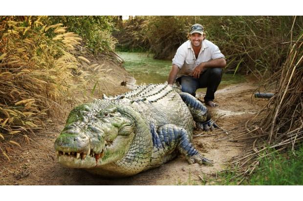 Matt and his pet croc Tripod say cheese