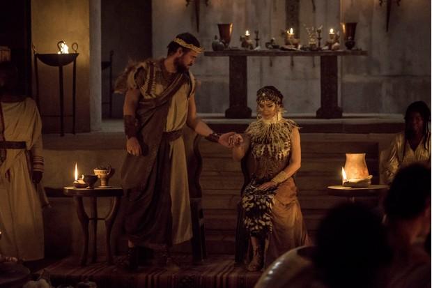 Menelaus (Jonas Armstrong) and Helen (Bella Dayne)