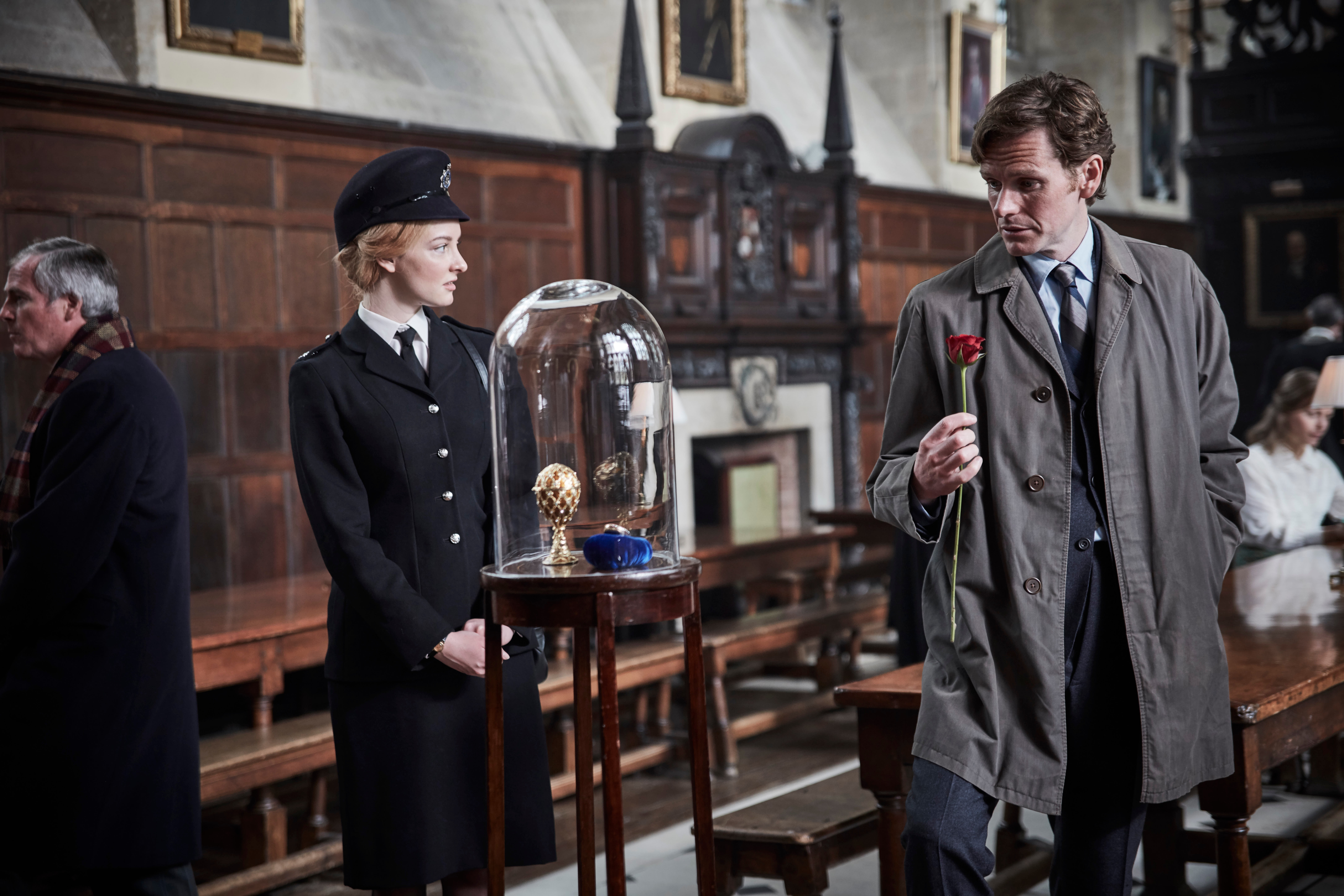 FROM MAMMOTH SCREEN FOR ITV  ENDEAVOUR ON ITV1  Pictured: DAKOTA BLUE RICHARDS as WPC Shirley Tewlove and SHAUN EVANS as Detective Sgt Endeavour Morse  Past and present collide in Oxford, as the auction of a priceless Faberge Egg gets underway at Lonsdale College. It soon attracts the attention of an infamous international thief - and consequently the newly christened Thames Valley Constabulary - as Endeavour (Shaun Evans) investigates a failed burglary attempt.   They soon have a bigger case to solve, as the gruesome death of a known gangster threatens to expose the growing threat of underworld Oxford. But when a Lonsdale don connected to the auction is murdered in a similarly grisly way, Endeavour begins to suspect the seemingly separate cases may be somehow connected. When the organiser of the auction also meets a bloodthirsty end, he's convinced. The hunt is underway to find a ruthless and violent serial killer, and track down the next victim before it's too late.   Meanwhile, newly-promoted Endeavour struggles with his role as he's forced to mentor young detective constable George Fancy (Lewis Peek), and a surprise reappearance opens up old wounds.  This photograph is (C) iTV and can only be reproduced for editorial purposes directly in connection with the programme or event mentioned above. Once made available by ITV plc Picture Desk, this photograph can be reproduced once only up until the transmission [TX] date and no reproduction fee will be charged. Any subsequent usage may incur a fee. This photograph must not be manipulated [excluding basic cropping] in a manner which alters the visual appearance of the person photographed deemed detrimental or inappropriate by ITV plc Picture Desk.  This photograph must not be syndicated to any other company, publication or website, or permanently archived, without the express written permission of ITV Plc Picture Desk. Full Terms and conditions are available on the website www.itvpictures.com  For further information p