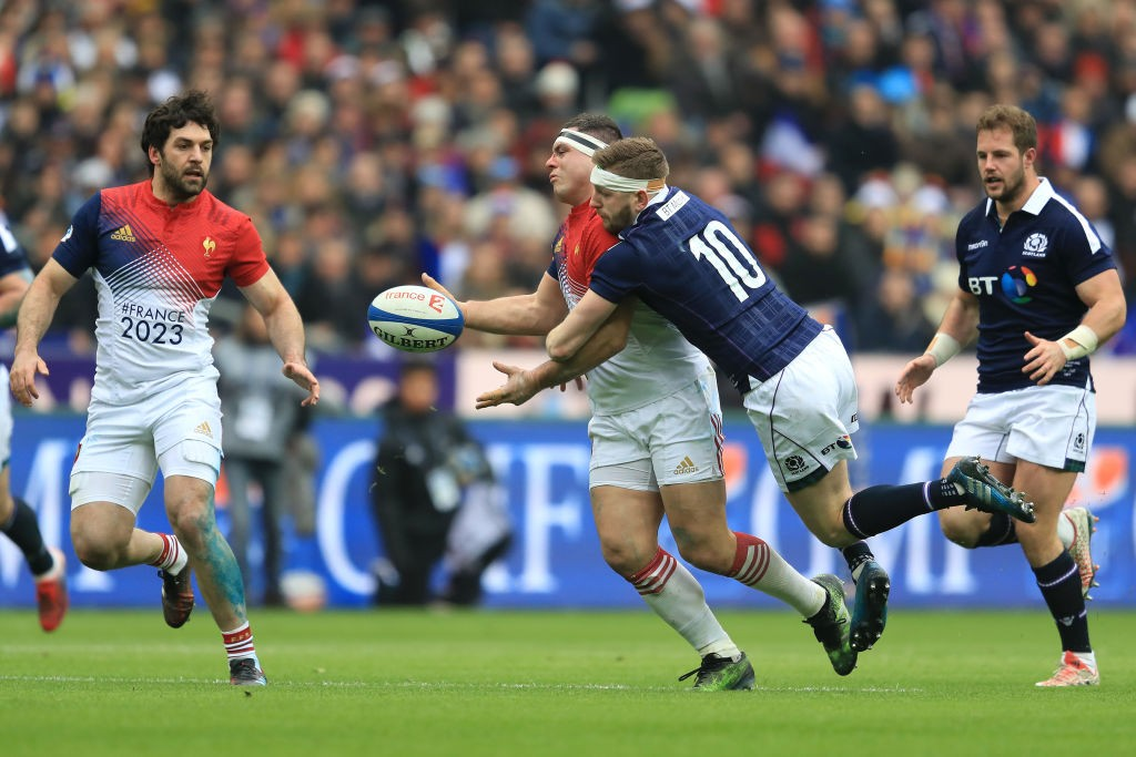 PARIS, FRANCE - FEBRUARY 12:  Guilhem Guirado of France takes a high ball under pressure from Finn Russell of Scotland during the RBS Six Nations match between France and Scotland at the Stade de France on February 12, 2017 in Paris, France.  (Photo by Richard Heathcote/Getty Images)