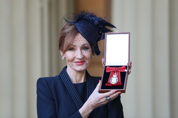 JK Rowling poses with her medal after being made a Companion of Honour for services to literature and philanthropy (Getty, EH)