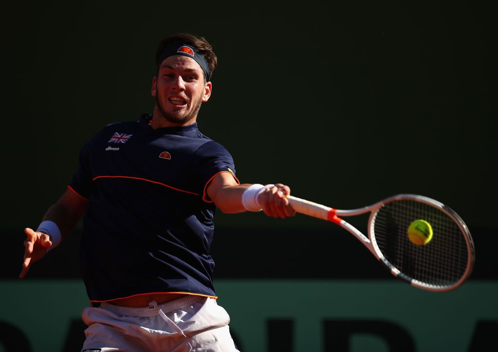 MARBELLA, SPAIN - FEBRUARY 02:  Cam Norrie of Great Britain in action against Roberto Bautista Agut of Spain during day one of the Davis Cup World Group first round match between Spain and Great Britain at Club de Tenis Puente Romano on February 2, 2018 in Marbella, Spain.  (Photo by Julian Finney/Getty Images)