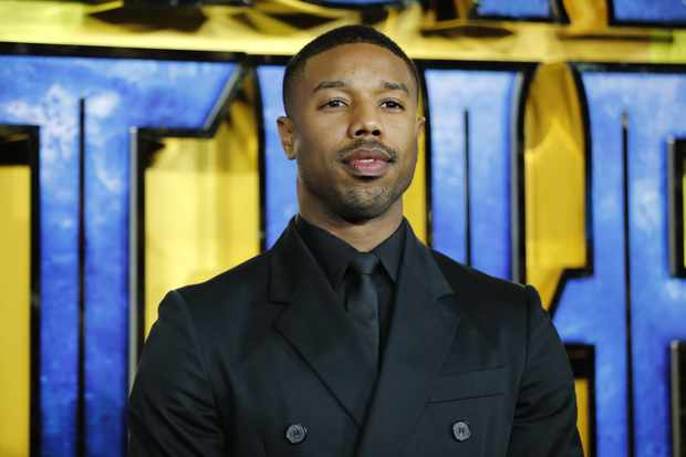 American actor Michael B Jordan poses on arrival for the European Premiere of 'Black Panther' in central London on February 8, 2018. / AFP PHOTO / Tolga AKMEN        (Photo credit should read TOLGA AKMEN/AFP/Getty Images)